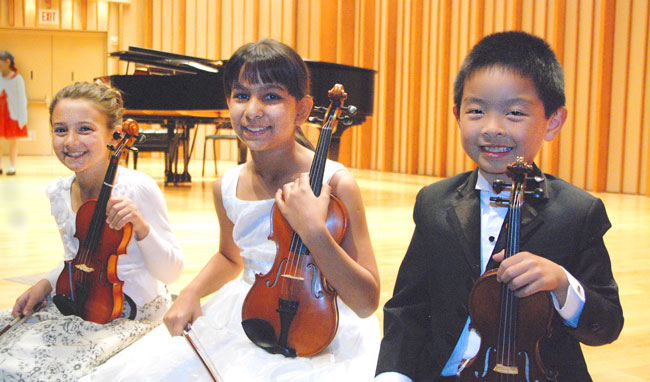 2014 Graduation at Zipper Hall, from left, Maya Rustenburg, Sophie Peltz and Benjamin Wong